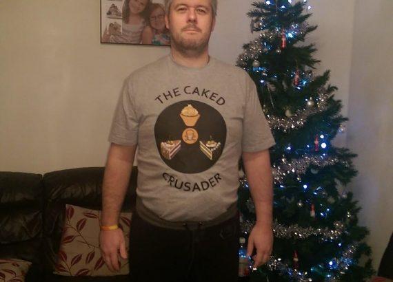 Paul wearing caked-crusader t-shirt