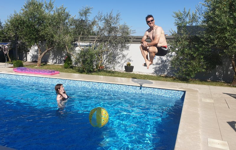 Paul jumping into a pool