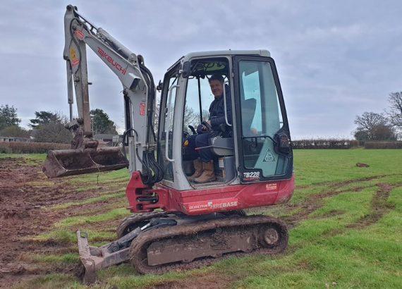 Paul in an excavator